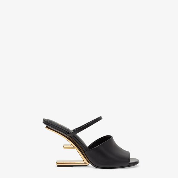 Black leather high-heeled sandals
