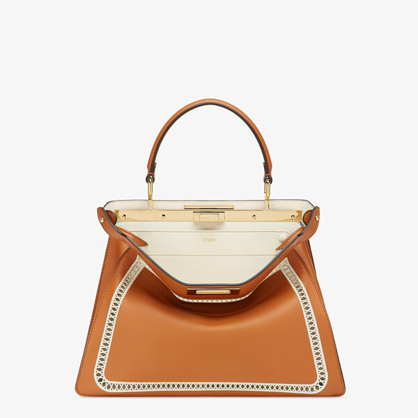 Embroidered brown leather bag