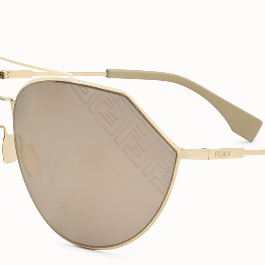 FENDI EYELINE 2.0 - Occhiali da sole beige e oro - vista 3 dettaglio