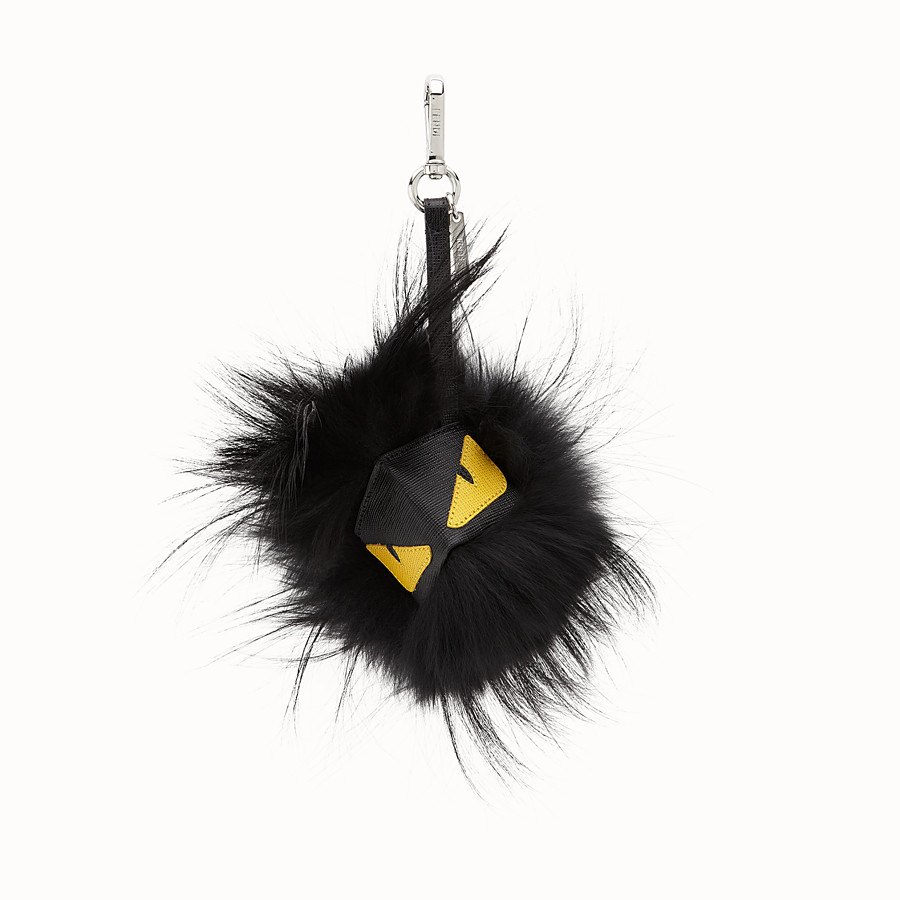 54325927ab6 in black fur with yellow eyes - BAG BUG | Fendi